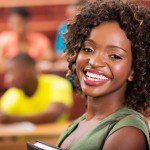 portrait of pretty african college student in lecture room